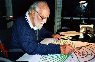 Douglas at home, designing a map